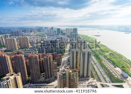 Aerial view of city buildings and river, China Nanchang