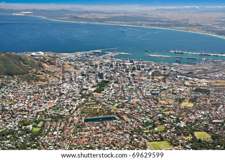 aerial view of city of Cape Town as seen from table mountain with table bay and harbor - stock photo