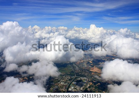 Aerial view of cloudscape over a cityscape.