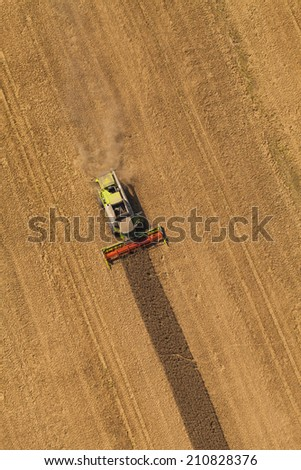aerial view of combine on harvest field  - stock photo