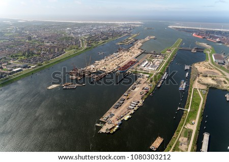 Aerial view of construction work at the new sluice in IJmuiden, Holland. For the largest boats and ships a new sea lock is now being built in the Noordzeekanaal.