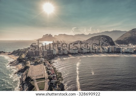 Aerial view of Copacabana Beach in Rio de Janeiro with light leak, Brazil - stock photo