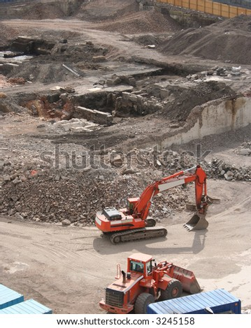 aerial view of demolition site with heavy machinery - stock photo