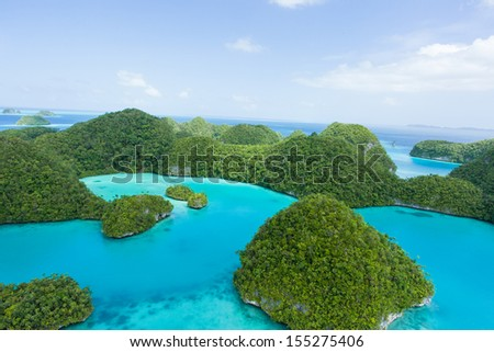 Aerial view of deserted tropical rock islands covered in lush vegetation, Palau Seventy Islands - stock photo