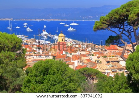 Aerial view of distant buildings and church tower of Saint Tropez, French Riviera, France - stock photo