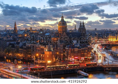 Aerial view of downtown Amsterdam, The Netherlands during a dramatic beautiful sunset.  - stock photo