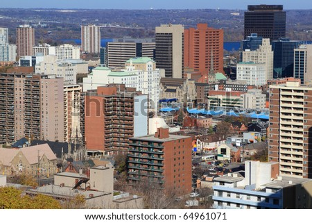 Aerial view of downtown Hamilton, Ontario, Canada, with Lake Ontario on background and surrounding forest. Horizontal orientation. - stock photo