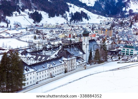 Aerial view of Engelberg, Switzerland, a snowy village in the mountains - stock photo