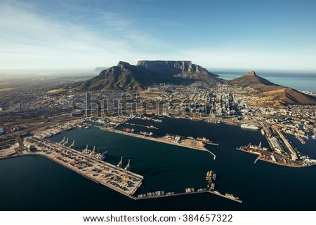 Aerial view of entrance of the port of cape town. Commercial docks of cape town harbour. - stock photo