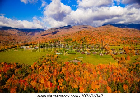 Aerial view of fall foliage including Trapp Family Lodge, Stowe, Vermont, USA - stock photo