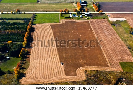 Aerial view of farmland in the fall - stock photo