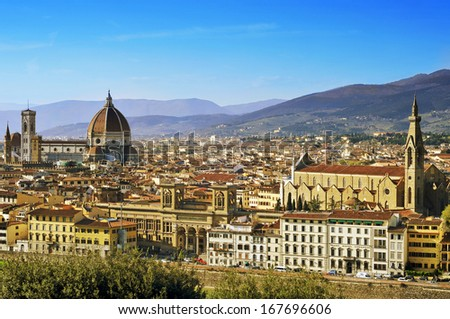 aerial view of Florence, Italy, where highlight the Duomo and the Basilica di Santa Croce - stock photo