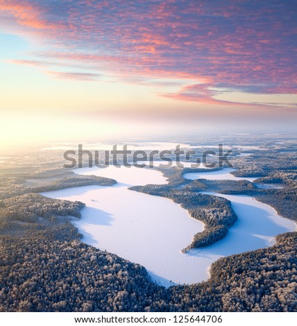 Aerial view of forest lakes in time of winter day. - stock photo