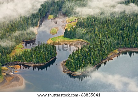 Aerial view of forests, lakes, and mist in the Tongass temperate rain forest, Misty Fjords National Monument, Alaska - stock photo