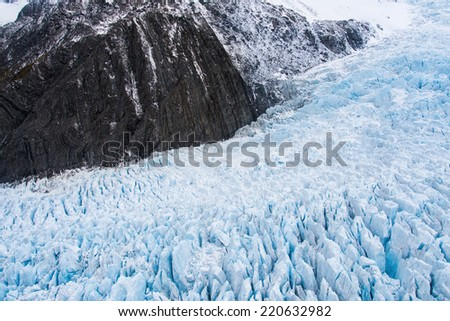 Aerial view of Fox Glacier on the west coast of New Zealand - stock photo