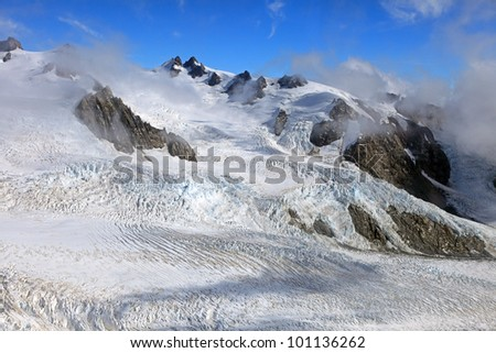 Aerial view of Franz Josef glacier from helicopter, Westland Tai Poutini National Park on the West Coast of New Zealand - stock photo