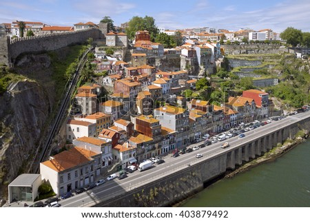 Aerial view of Funicular dos Guindais and picturesque houses in historic centre of Porto city, Portugal - stock photo