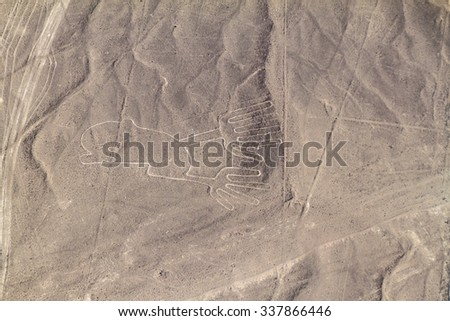 Aerial view of geoglyphs near Nazca - famous Nazca Lines, Peru. In the center, Hands figure is present. - stock photo