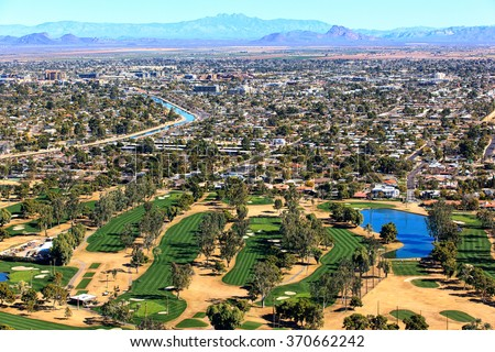 Aerial view of golf course with Scottsdale, Arizona skyline - stock photo