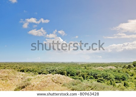 Aerial view of grassy dunes landscape on dutch island. Schiermonnikoog, Waddenisland, the Netherlands. - stock photo