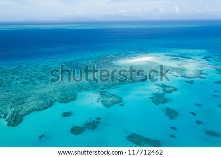 Aerial view of Great Barrier Reef and coral sand cay beach from helicopter, Queensland, Australia
