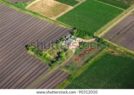 Aerial view of green agriculture fields in farm. Uruguay. - stock photo