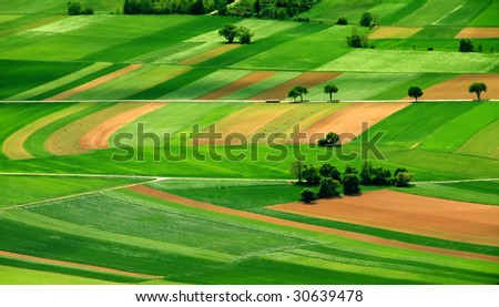 aerial view of green fields - stock photo