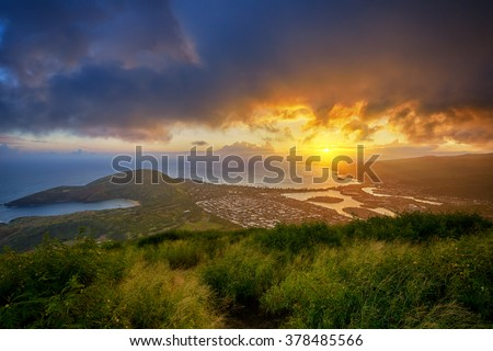 aerial view of Hanauma Bay and Diamond Head at sunset from a top of Koko Head Crater, Oahu, Hawaii, USA - stock photo