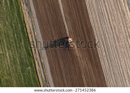aerial view of harvest fields with tractor in Poland - stock photo