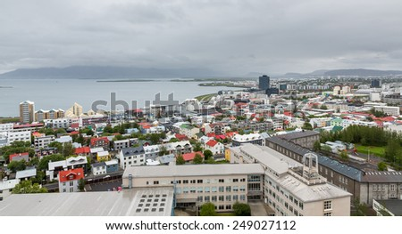 Aerial view of houses and coastline in Reykjavik, Iceland - stock photo