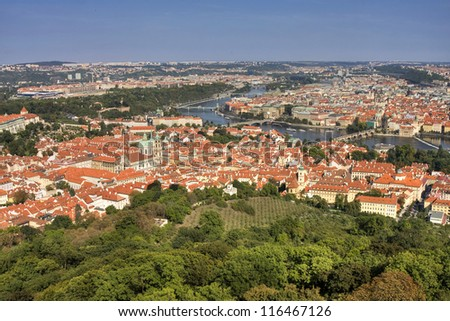Aerial view of houses and roofs of Prague old city town.