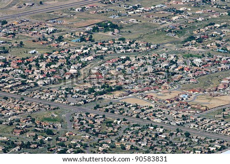 Aerial view of housing developments in the desert of Albuquerque, New Mexico - stock photo