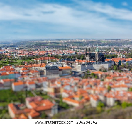 Aerial view of Hradchany part of Prague: the Saint Vitus Cathedral and Prague Castle, view from Petrin Observation Tower with tilt shift toy effect shallow depth of field. Prague, Czech Republic - stock photo