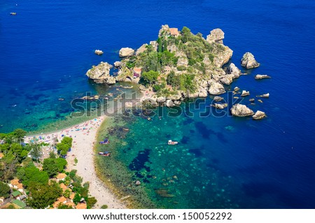 Aerial view of island and Isola Bella beach and blue ocean water in Taormina, Sicily, Italy - stock photo