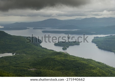 Aerial view of islands in a lake, Skeena-Queen Charlotte Regional District, Haida Gwaii, Graham Island, British Columbia, Canada - stock photo