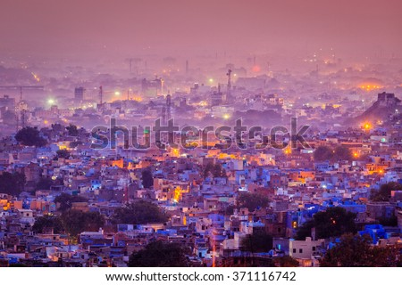 "Aerial view of Jodhpur (aka ""Blue City"" due to the vivid blue-painted Brahmin houses around Mehrangarh Fort in the evening twilight. Jodphur, Rajasthan"