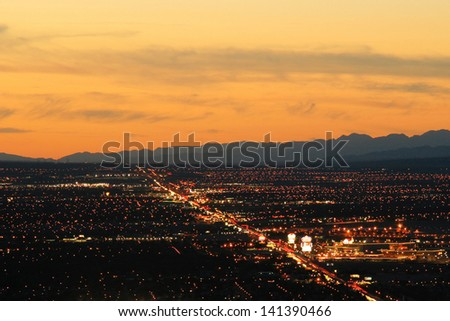 Aerial view of Las Vegas city illuminated at night, Nevada, U.S.A. - stock photo