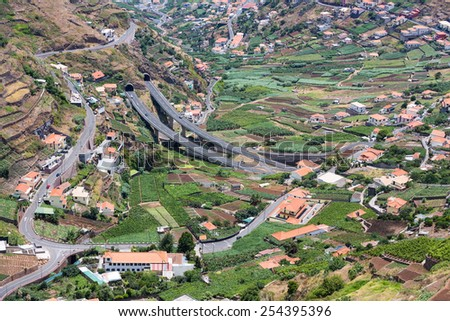 Aerial view of little villages and a highway in the mountains of Madeira Island, Portugal - stock photo