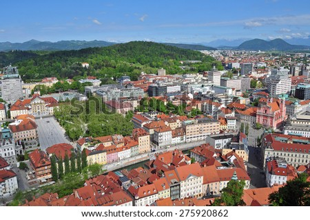 Aerial view of Ljubljanas old city center with Roznik hill in the background - stock photo