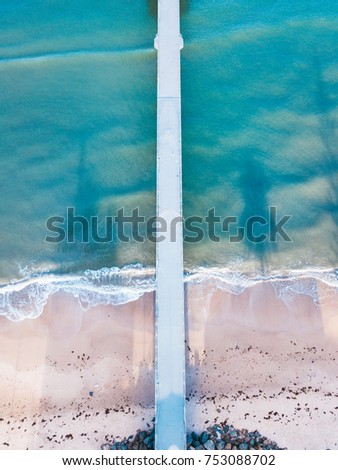 Aerial view of long jetty towards the ocean
