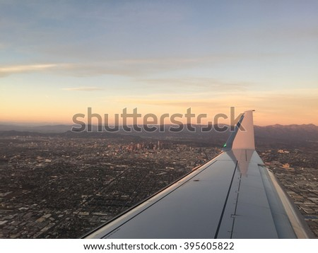 Aerial view of los angeles downtown through plane window - stock photo