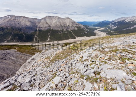 Aerial view of MacDonald Creek valley and Alaska Highway in Stone Mountain Provincial Park, British Columbia, Canada - stock photo