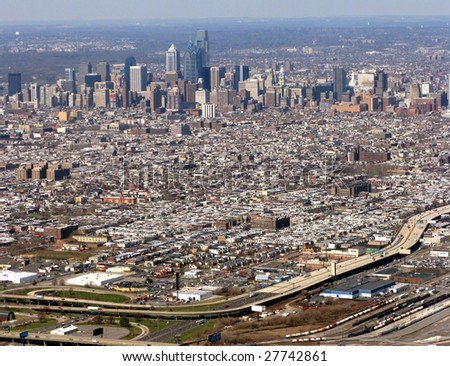 Aerial view of major American city Philadelphia Pennsylvania with Downtown Center City commercial business district and residential South Philly area with highway interstate I-95 in foreground - stock photo