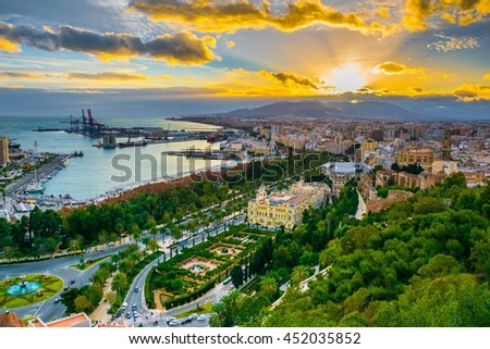 aerial view of malaga taken from gibralfaro castle including port of malaga, alcazaba castle and the cathedral of malaga during sunset - stock photo