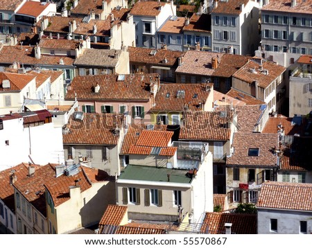 Aerial view of many red roofs at Marseilles, France, by sunny day - stock photo