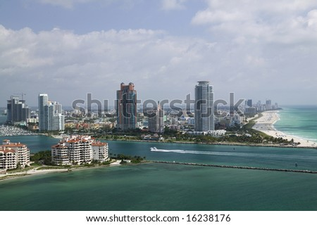 Aerial view of Miami Beach's Government cut and Fisher Island - stock photo