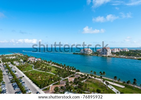Aerial View of Miami South Pointe Park and Fisher Island. - stock photo