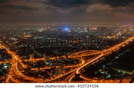 Aerial view of modern big city at night (warm colors)