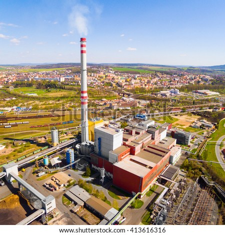 Aerial view of modern combined heat and power plant. Fuming chimney with sulphur removal unit. Heavy industry from above. Power and fuel generation in Czech Republic, European Union.  - stock photo