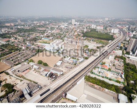 Aerial view of modern high rise building under construction in Tiwanon area, Nonthaburi, Thailand